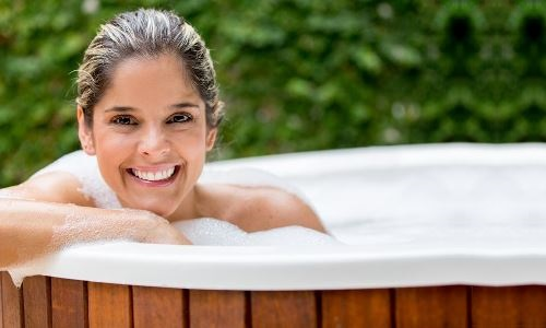 Woman relaxing in a hot tub.