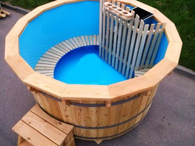 Wooden hot tub with plastic interior